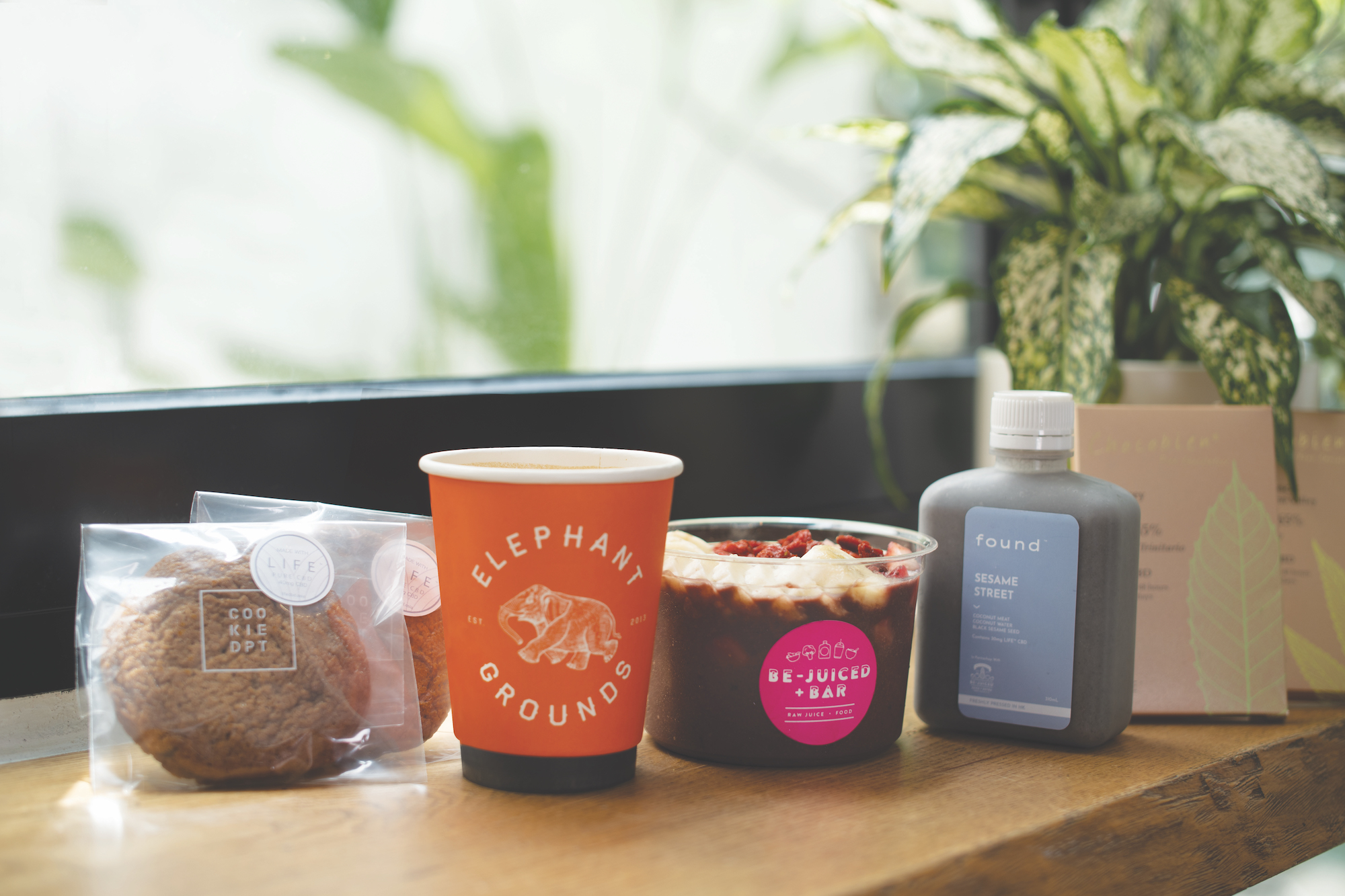 A cookie, coffee, acai bowl, juice and chocolate all infused with LIFE products