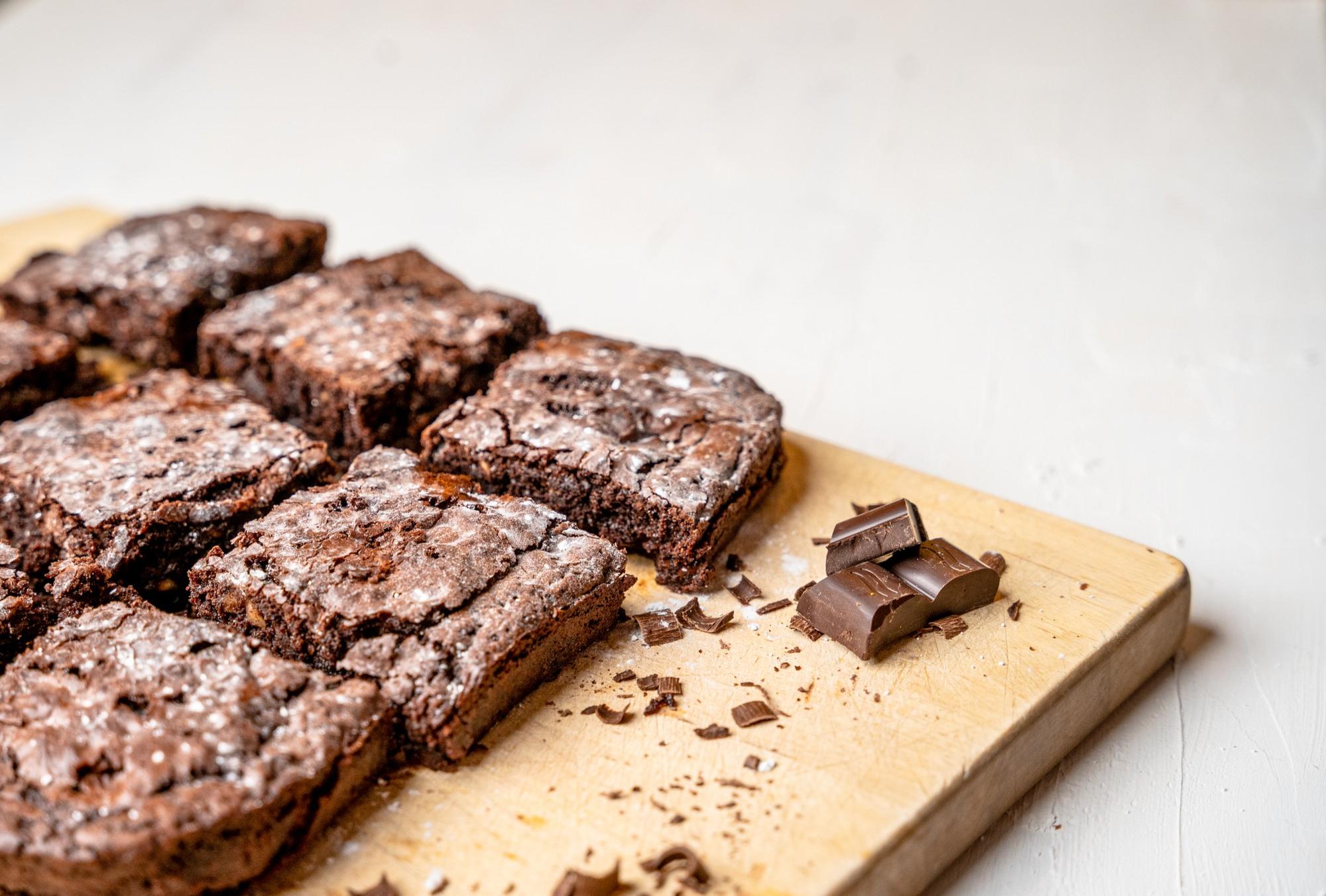 closeup-freshly-baked-brownies-wooden-board