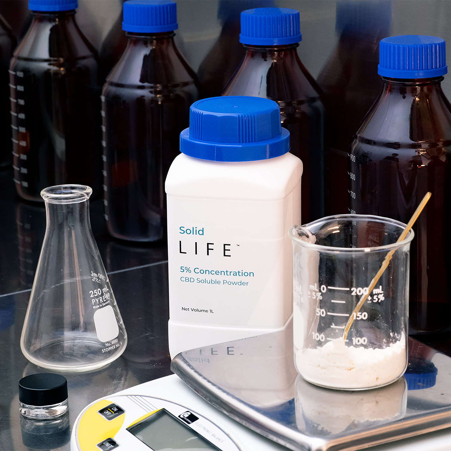 A commercial kitchen with Solid LIFE CBD being weighed